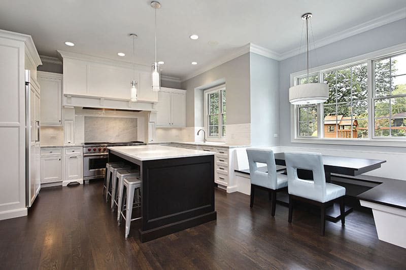 Black And White Kitchen Island Blends With Cabinets Bright Ceiling And Floor