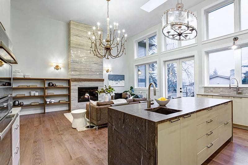 Granite Top Island In Bright Airy Living And Kitchen Room With A Firestone