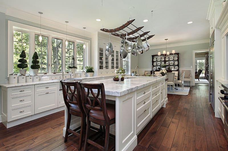 Kitchen In Luxury Home With White Bar Style Kitchen Island