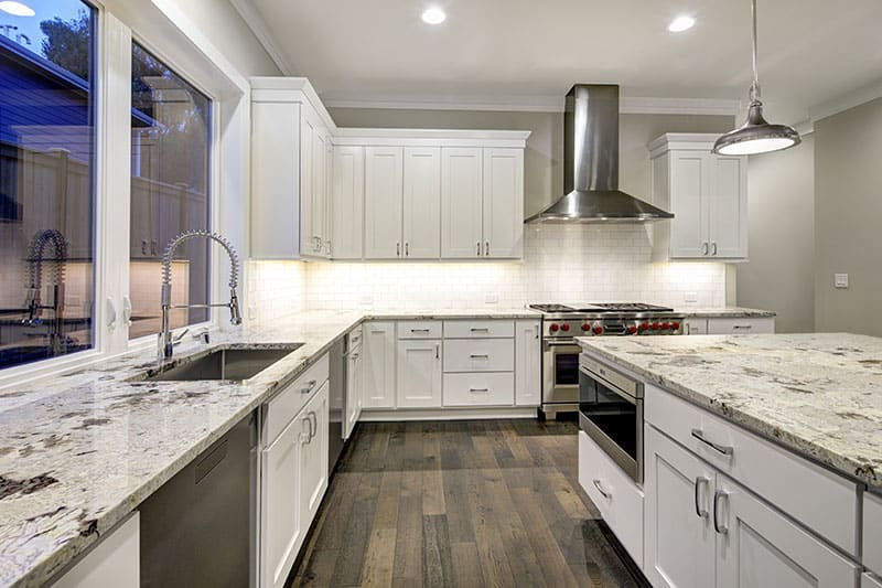 Large Island In A Spacious Kitchen Design With A Cool Blend Of Colors