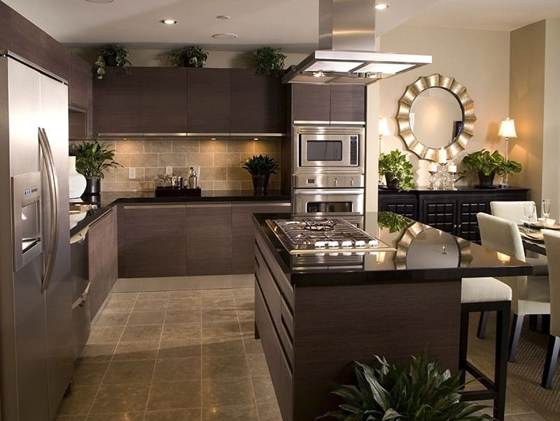 Rectangular Dark Brown Island In A Warm And Inviting Kitchen
