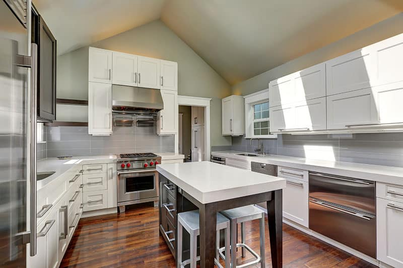 White Top Island In A Modern Style Kitchen With Vaulted Ceiling