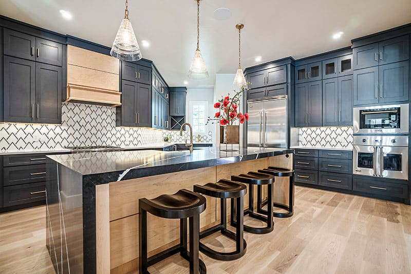 Black Island Blends Well With Wooden Cabinet And Floor