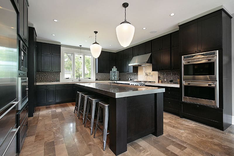 Dark Toned Wood As Kitchen Cabinetry And Island Creates A Modern Powerful And Vibrant Design