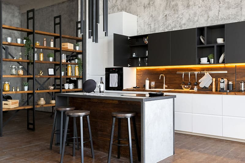 Island In A Luxury Studio Apartment With A Free Layout In A Loft Style In Dark Colors