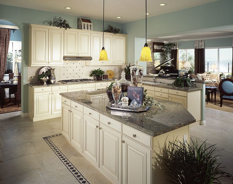 Large Island And Traditional Lightning In A Contemporary Kitchen