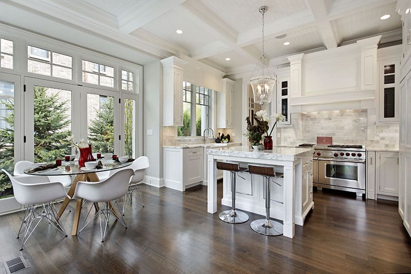Marble Topped Small White Kitchen Island In A Luxurious Kitchen
