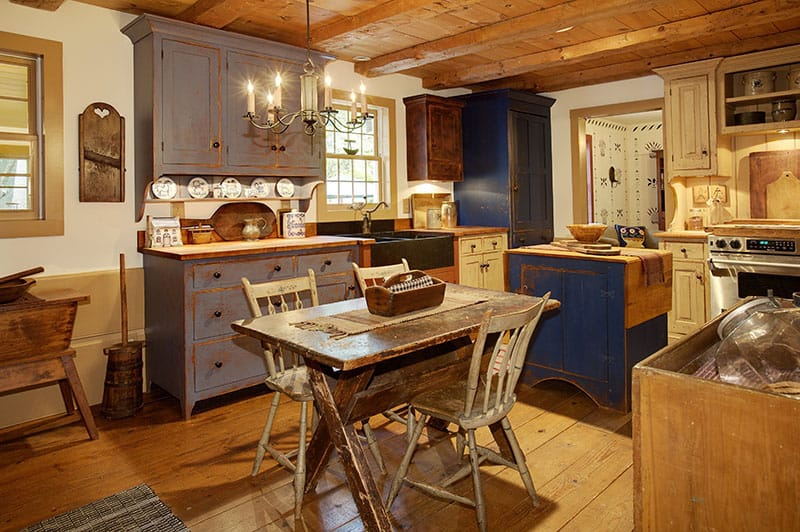 Primitive Colonial Style Reproduction Home With Some Small Kitchen Islands