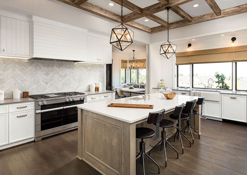 Simple Island Blends In With Hardwood Tile And Timber Tamed Ceiling