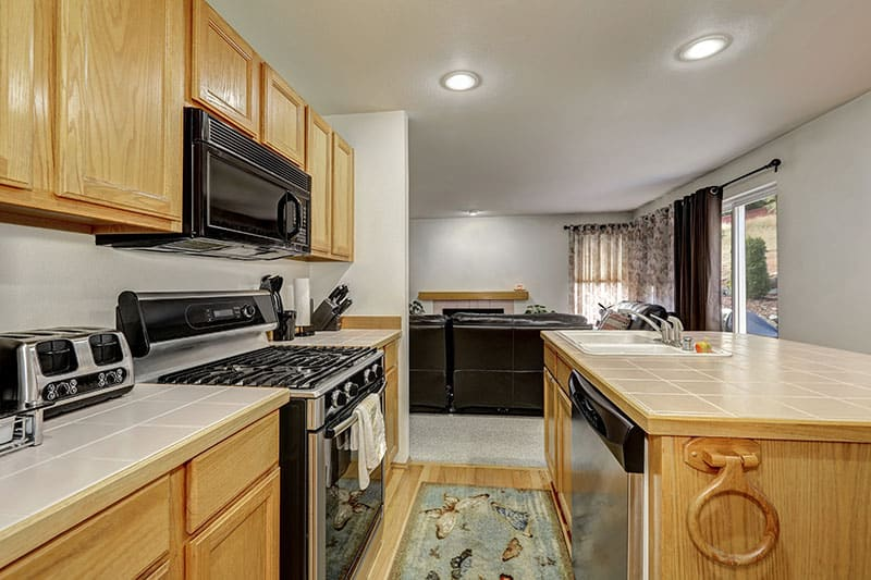 Skillful Arrangement Of Sink Kitchen Island And Other Furniture In A Newly Finished Apartment