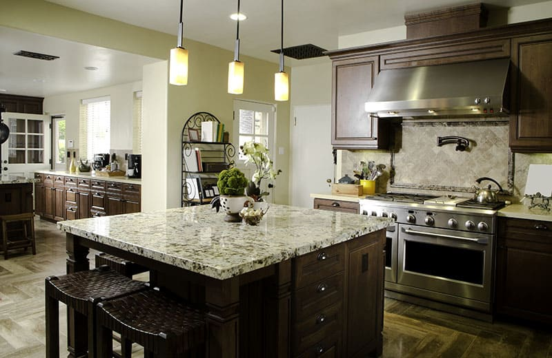 Square Island In An Open Ended Kitchen Seeing The Living Room Dining Room Bathroom