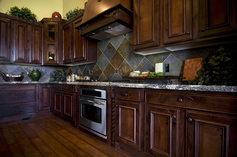 Dark Flooring And Cabinets With An Authentic Arrangement Of Kitchen