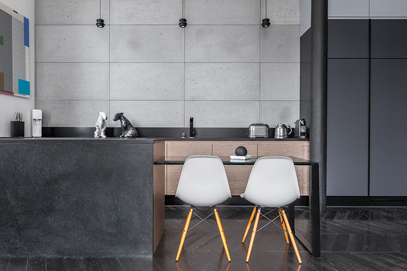 Black Hardwood Flooring Blends Perfectly With The Cabinets And Island Balanced By The Greyish Wall