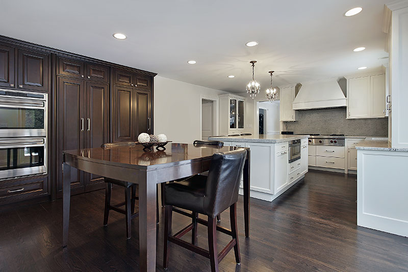Deep Wooden Brown Floor Cabinets And Table Creates A Dynamic Contrast With The Kitchen Island