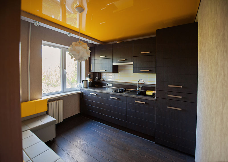 Kitchen Exudes Warmth Supported By A Dark Brown Floor That Matches The Kitchen Cabinets