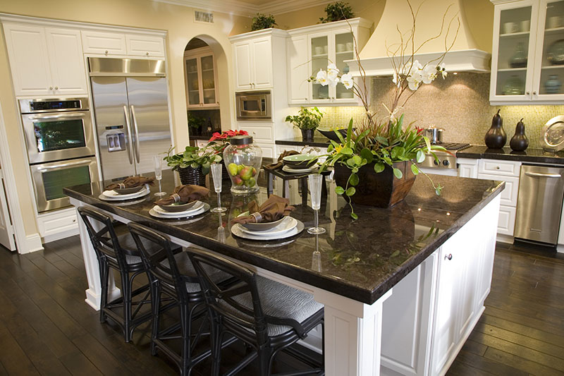 Kitchen With A Hardwood Floor And Breakfast Table With A Charming Color Palette