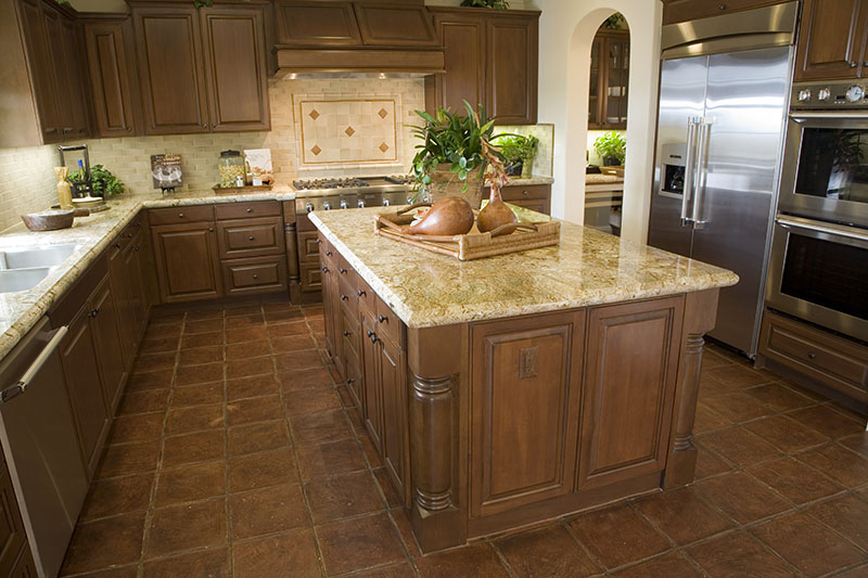 Light Brown Kitchen Design With Tile Matching The Brown Wood Of The Island And Cabinetry