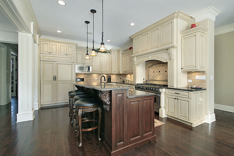 Traditional Look Of The Kitchen Magnified With The Rustic Wooden Island And Cabinet