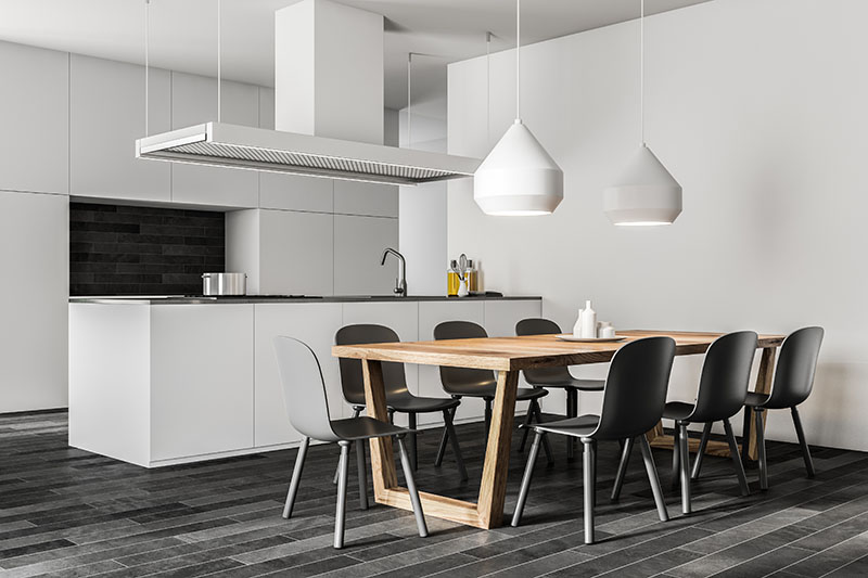 White Wall Kitchen Contrasts With Black Chair And Tile Flooring