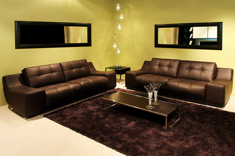 A Brown Rug to Frame the Brown Leather Sofas