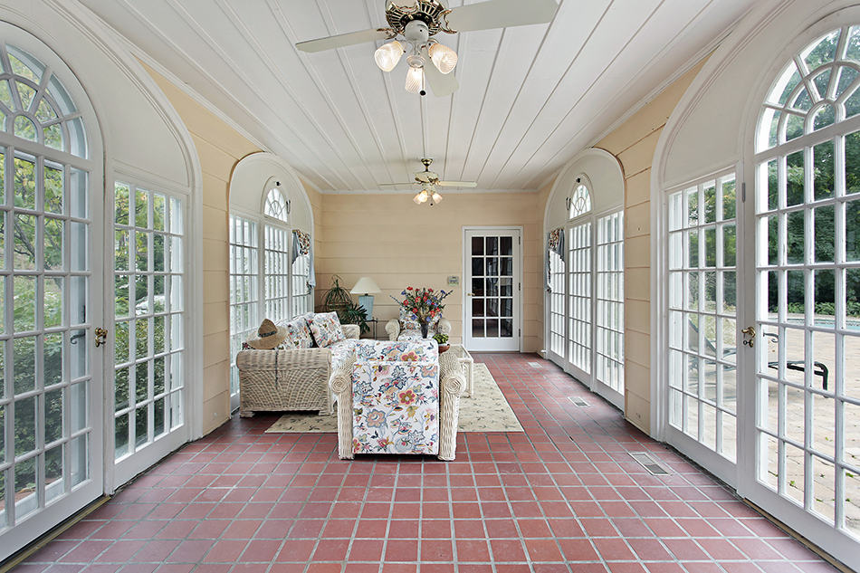 Breezeway Porch with Arched Doors and Red Brick Tile