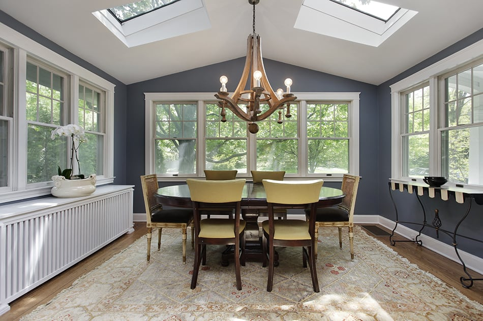 Dining Room with Wood Floor and Skylights