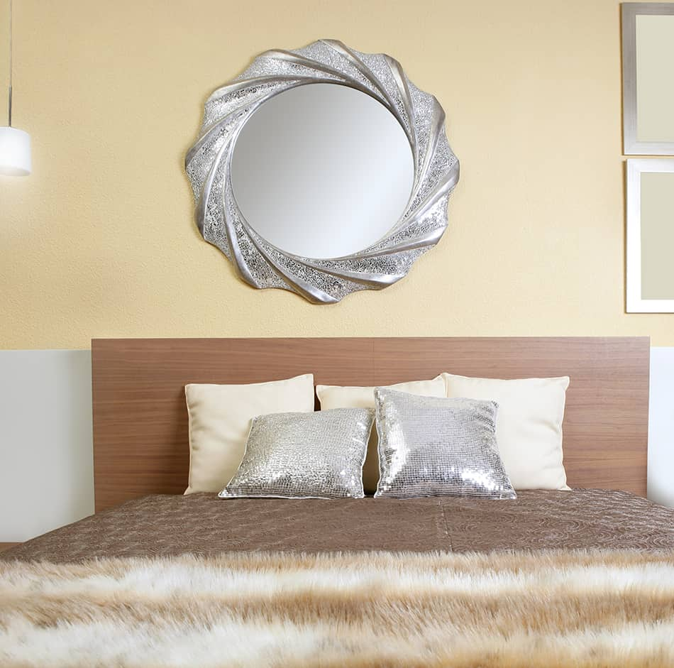 Hang a Stylish Mirror Above the Bed