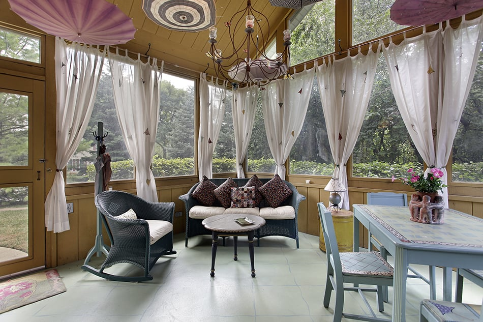 Intimate Porch with Wide Window and Sheer Curtains