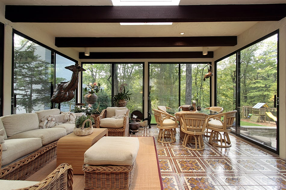 Sun Room with Rug and Patterned Tile Floor