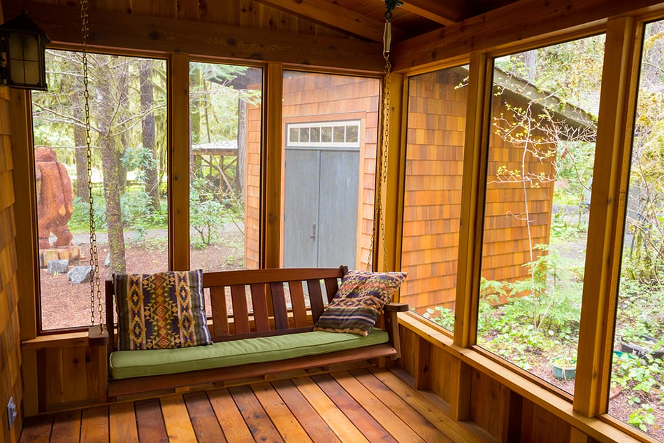 Wood Plank Porch with Bench Swing