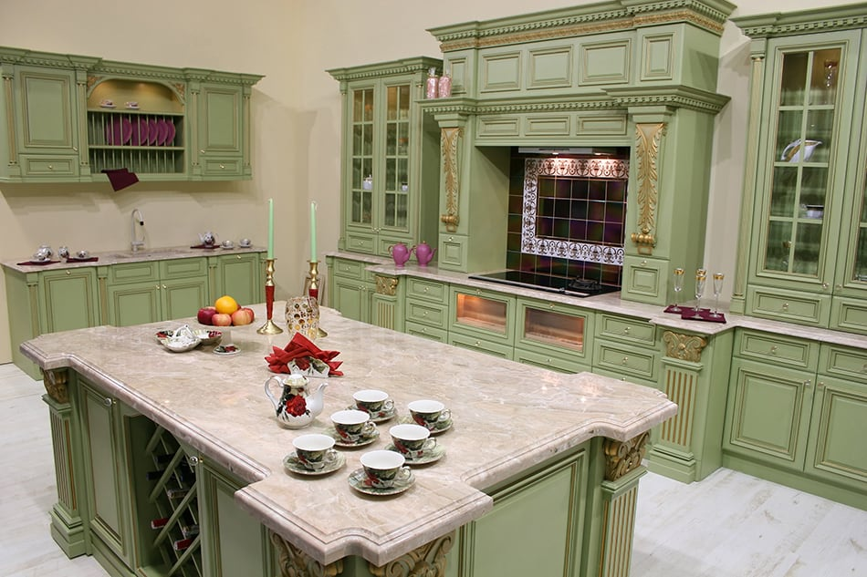 Sage green wooden cabinets