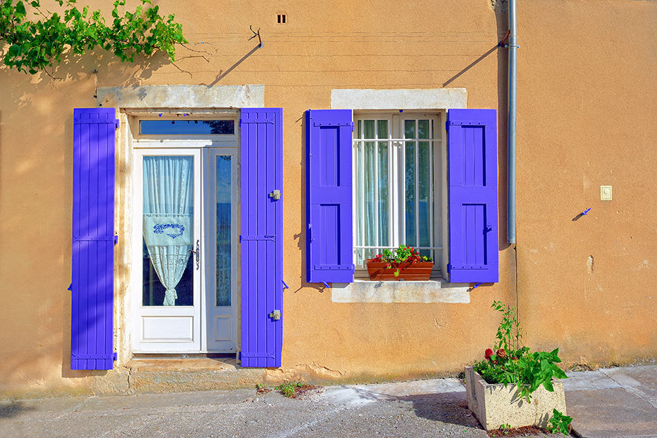 White Door with Purple Shutters