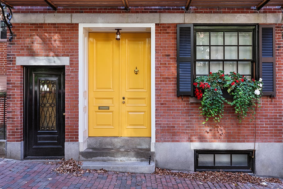 Yellow Door with Black Shutters