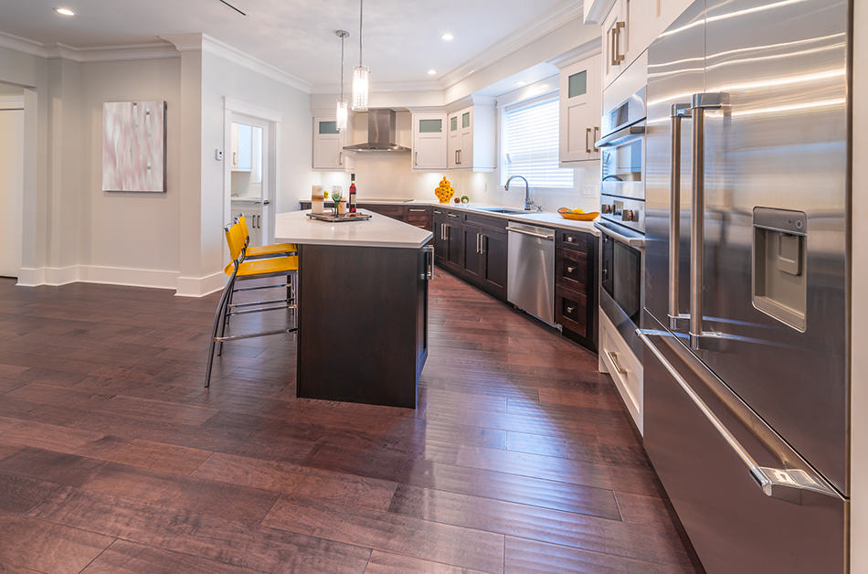 Black wooden cabinets with yellow stools
