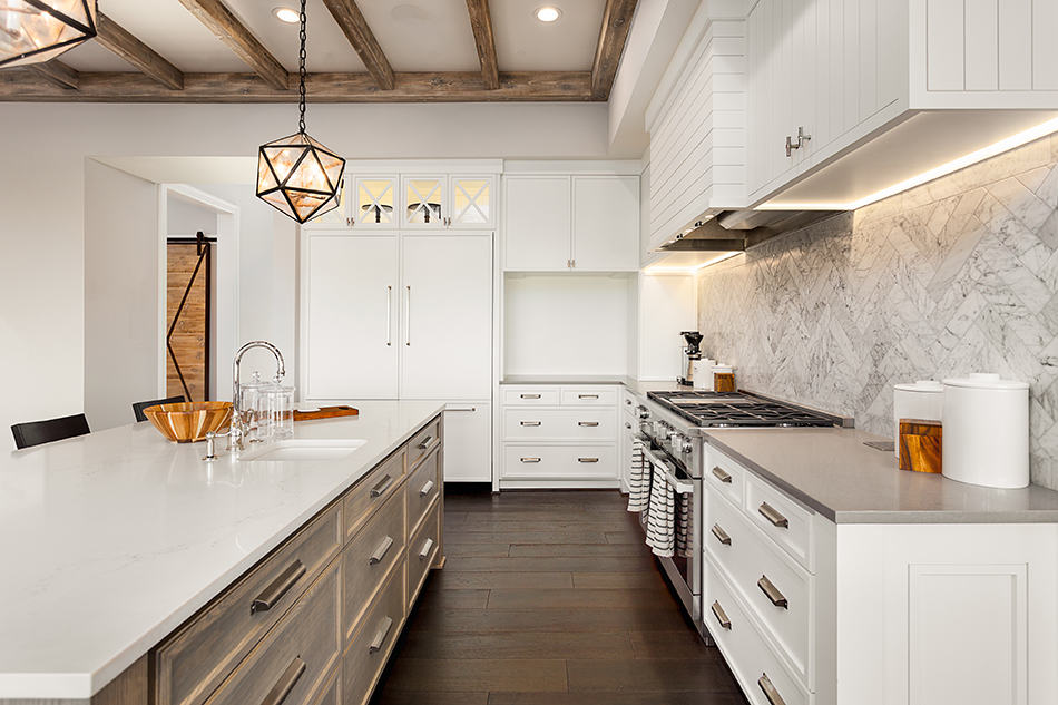 Pair white cabinets with white walls and pale accessories