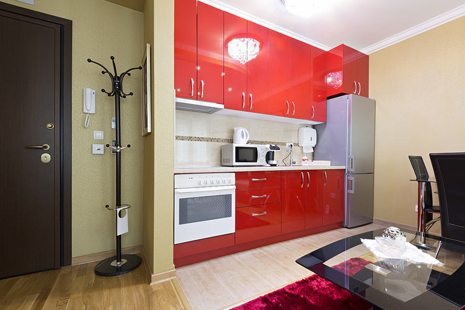 Red cabinets makes space bigger