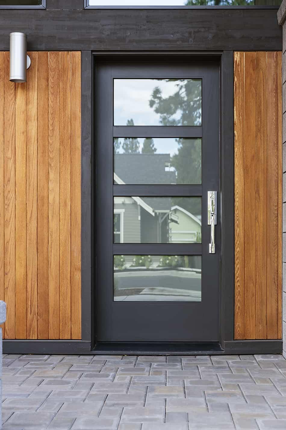 Black Door on Modern Brown House