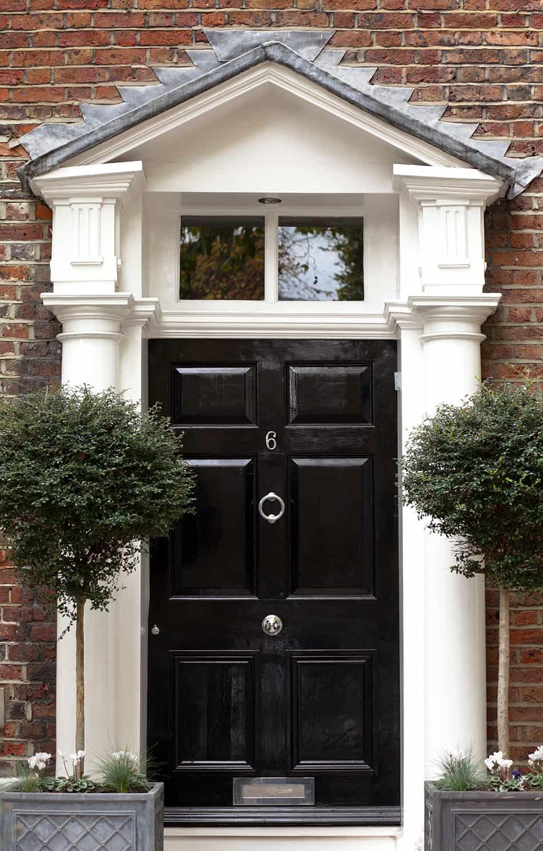Black Door on Traditional Brown Brick House