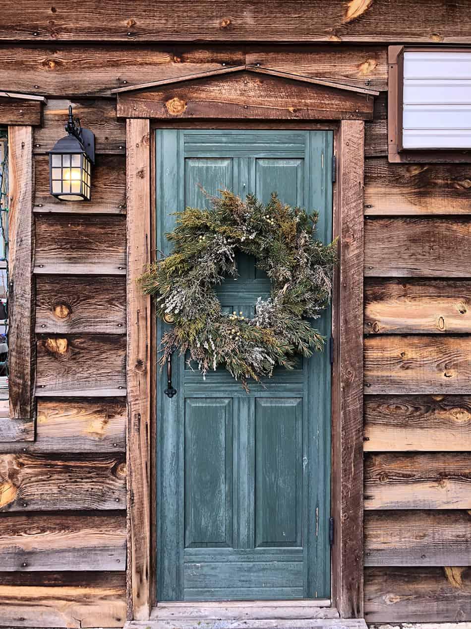 Blue Door on Rustic Brown Wooden Siding