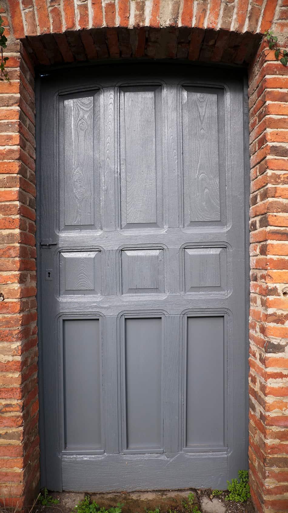 Bluish Gray Door on Brown Brick Exterior