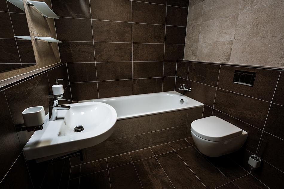 Dark Bathroom with Wall Hung Materials