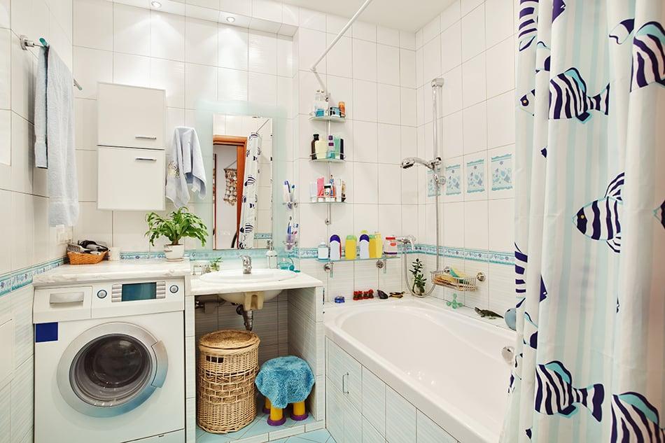 White Bathroom with Bathtub, Shower, and Washing Machine