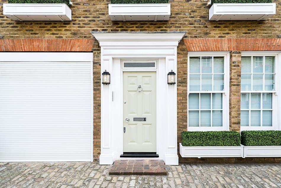 White Door on Brown Brick Exterior