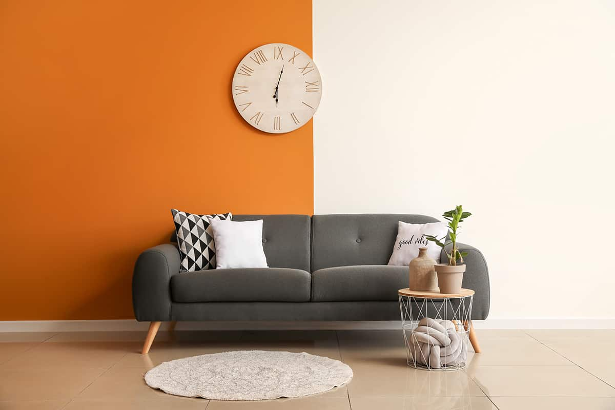 Pair the Charcoal Gray Couch with Orange Wall