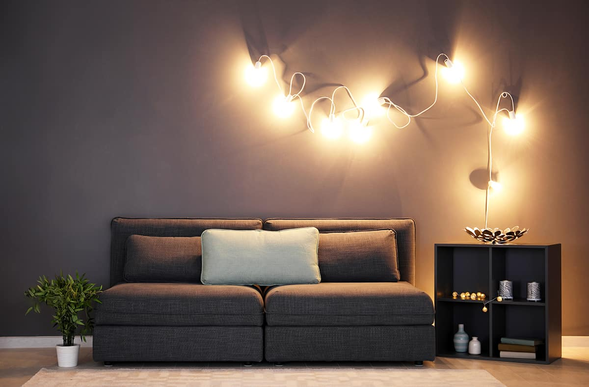 Warm Up the Charcoal Interior With Soft Lighting